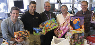Cummins volunteers who adapted toys