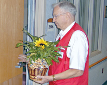 Volunteer delivering flowers at Regina Hospital
