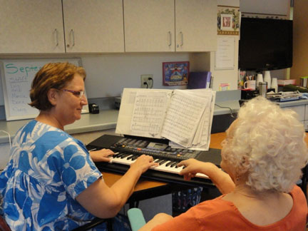 grace unit provider playing the piano for patient