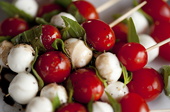 tomatoes and mozzarella balls on skewers