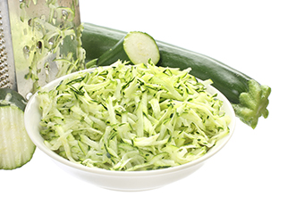 shredded zucchini in a bowl