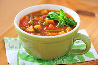 minestrone soup in mug cup