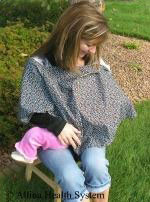 a blanket covers baby while breastfeeding in public