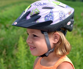 Girl wearing bike helmet