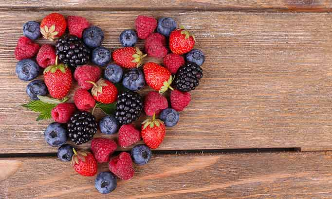 berries arranged in the shape of a heart, healthy valentines treats