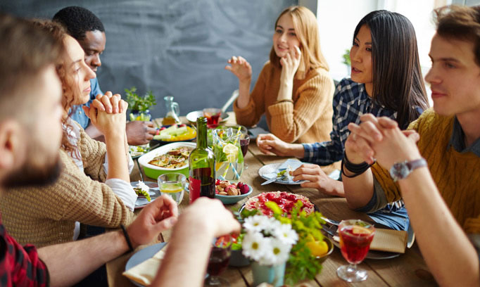 friends at dinner and how to handle holiday stress as an introvert