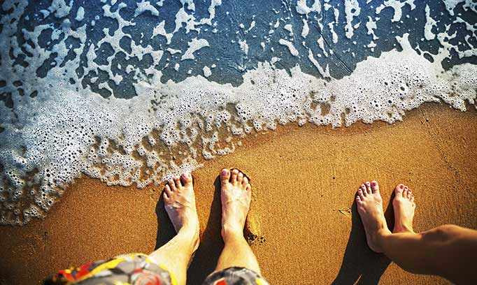feet on beach, how to avoid vacation stress