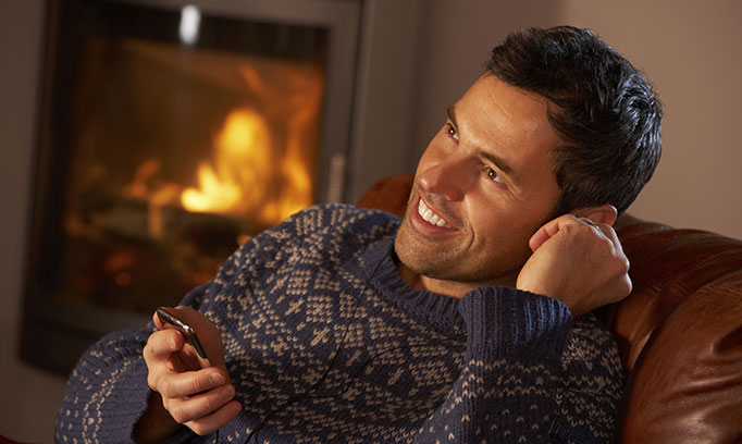 man by fireplace for story about how to get men to go to the doctor