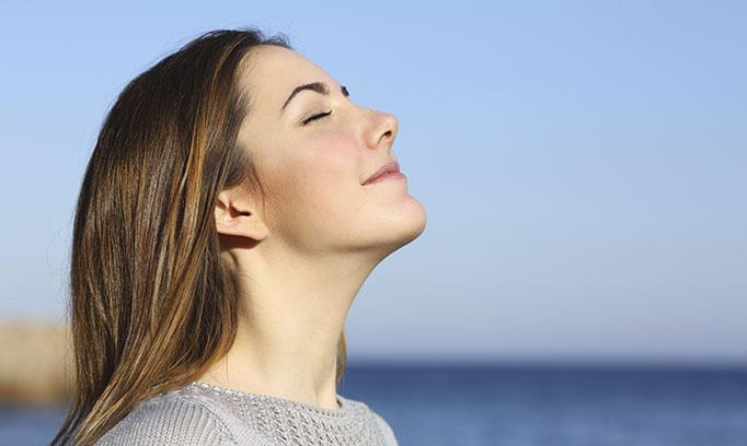 Woman feeling the benefits of deep breathing