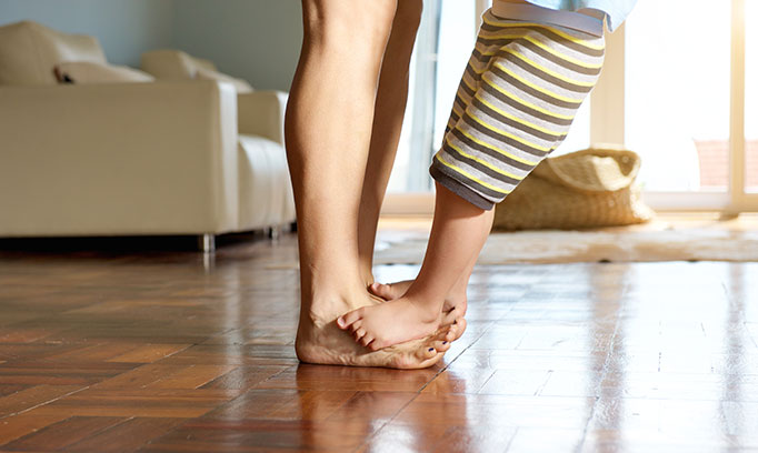 Mom with bare legs dancing with child