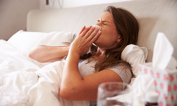 Woman sick in bed wanting cure for common cold