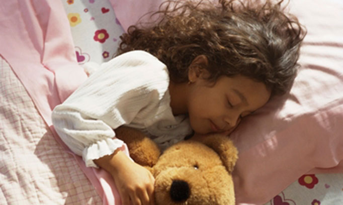 Young girl sleeping in advance of Daylight Saving Time