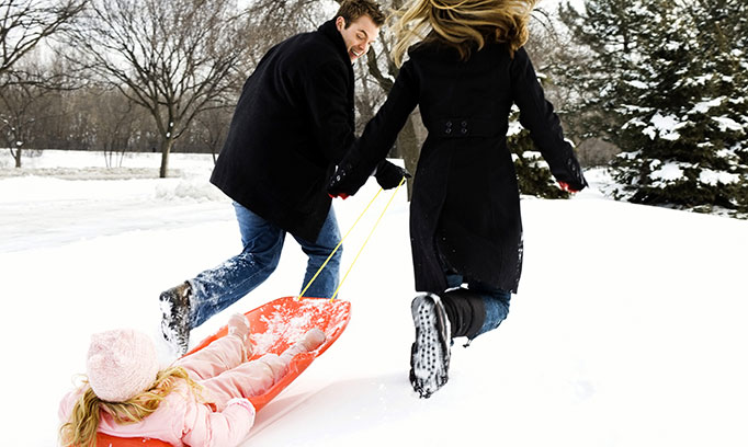 Couple dragging a sled