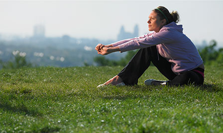 Woman contemplative resting in grass listicle size