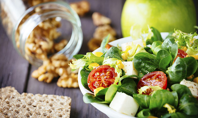 Leafy green salad with tomatoes and nuts are among the foods that help reduce the risk of colon cancer.