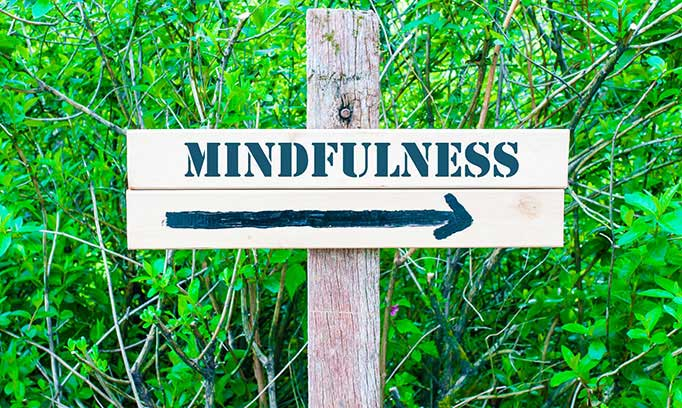 Mindfulness this way sign with an arrow