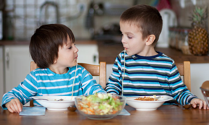 Kids enjoying family meal time and the benefits of eating together