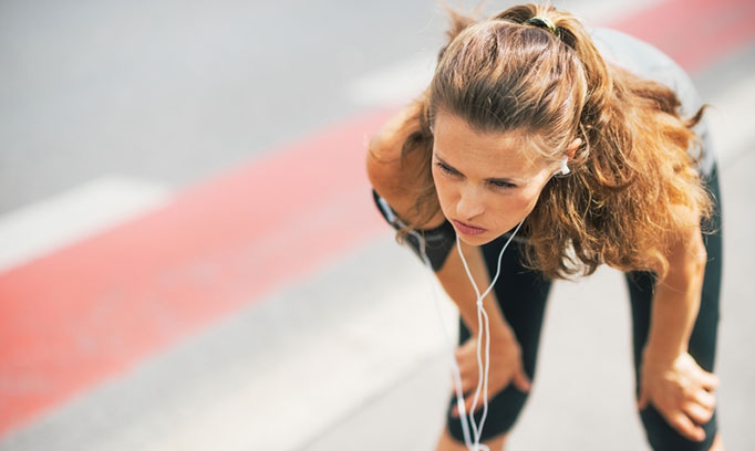 woman runner breathing hard because she's out of shape