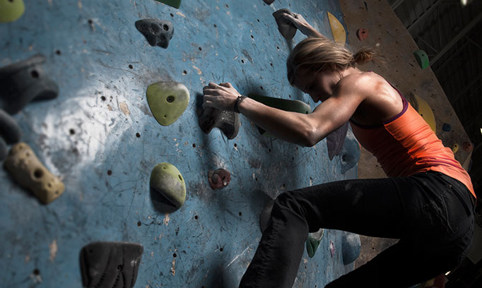 woman sweat working through rock climbing