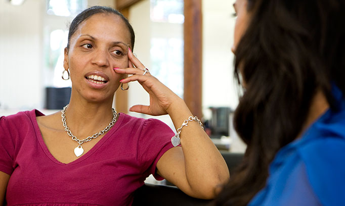A woman speaks to her therapist during a talk therapy session