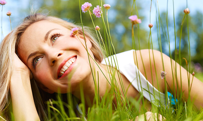 Woman takes time to notice the beauty of wildflowers and grasses