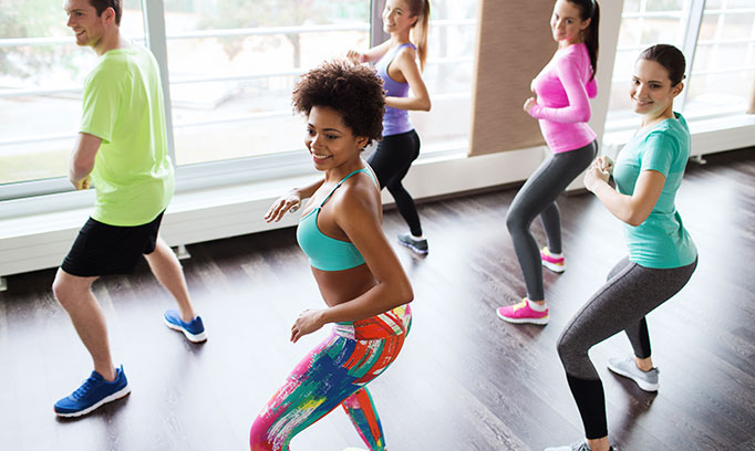 woman motivated to exercise in group class