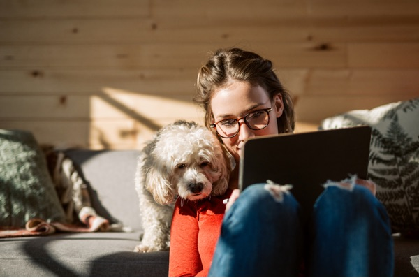 woman and dog at laptop
