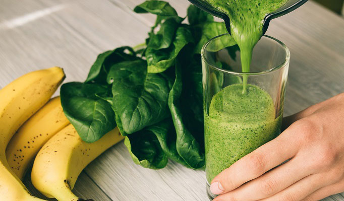 glass of healthier shamrock shake with bananas and spinach