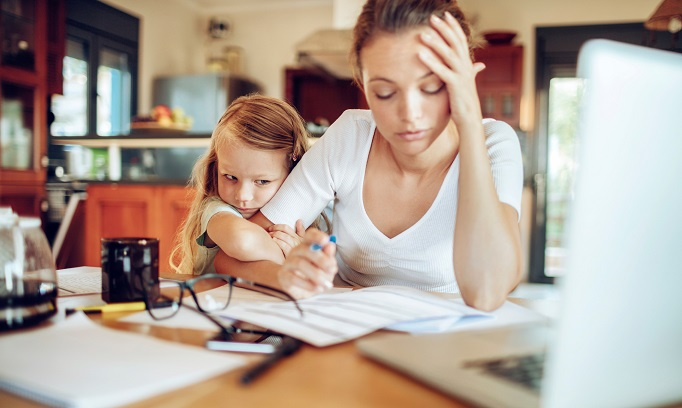 mother working from home with small daughter facing parental guilt 682x408