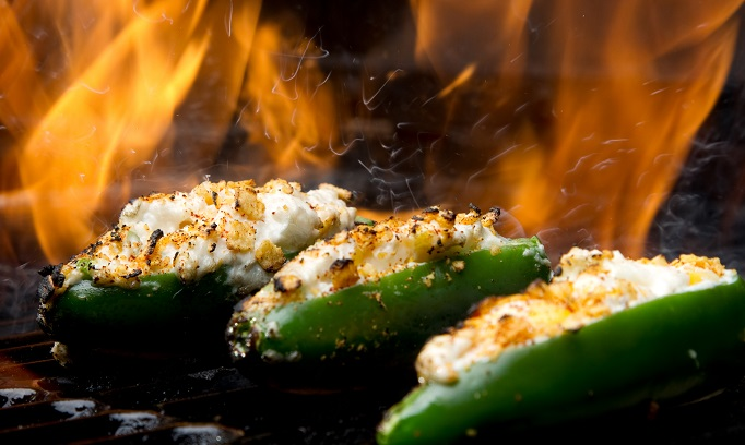 three mango stuffed jalapeno poppers on grill_156517808
